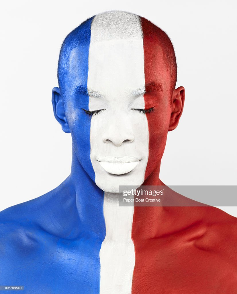French flag painted on man's face