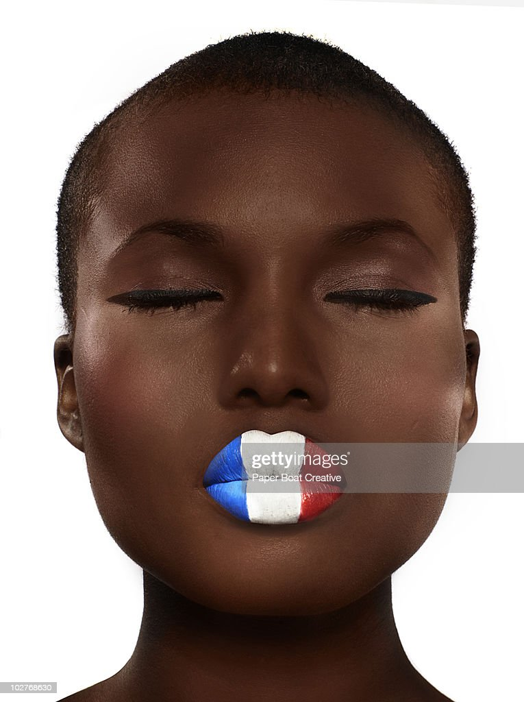 French flag painted on woman's lips