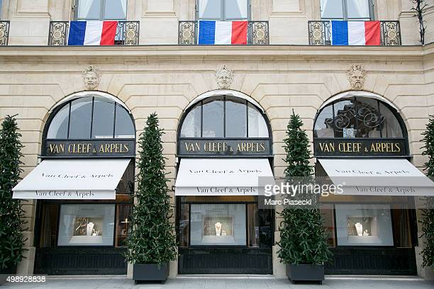 French flags are hung on balconies of the 'Van Cleef and Arpels' building on 'Place Vendome' in memory of the 130 victims of the Paris terrorist...