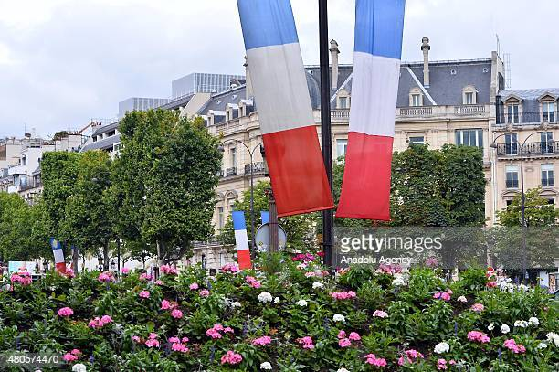 French flags are seen prior to Bastille Day in the traditional walk down the Champs Elysees in Paris France on July 13 2015