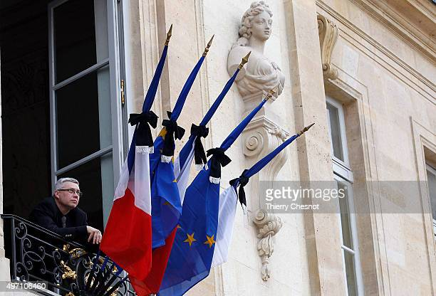 French flags are set at half mast after French president Francois Hollande declared three days of national mourning at the Elysee Palace on November...