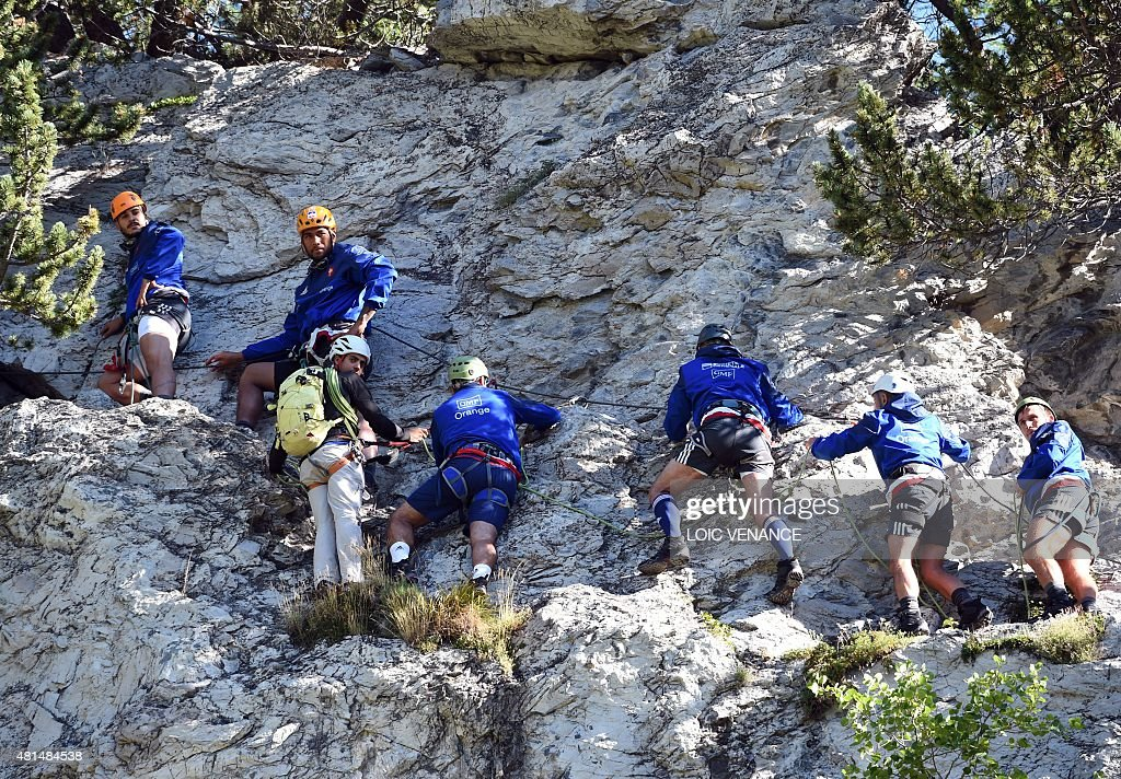 French flanker Sofiane Guitoune and French lock Sebastien Vahaamahina rock climb with rugby French team players during a Rugby Union World Cup 2015...