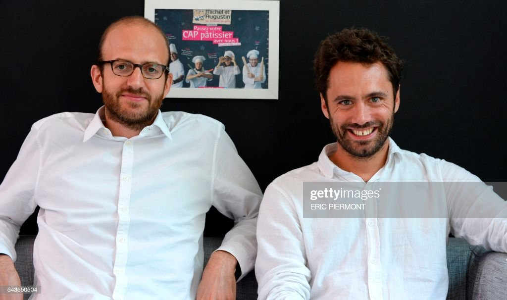 French food company Michel et Augustin co-founders and CEOs Augustin Paluel-Marmont (R) and Michel de Rovira (L) pose at the company headquarters in Boulogne Billancourt near Paris on June 29, 2016. French Food group Danone is in exclusive negotiations to acquire an interest of 40% in Michel et Augustin, Danone announced on June 28, 2016. / AFP / ERIC