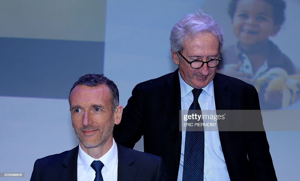 French Food group Danone Chairman of the Board of Directors Franck Riboud (R) and French Food group Danone CEO Emmanuel Faber arrive to address the group's annual shareholder meeting in Paris on April 28, 2016. / AFP / ERIC