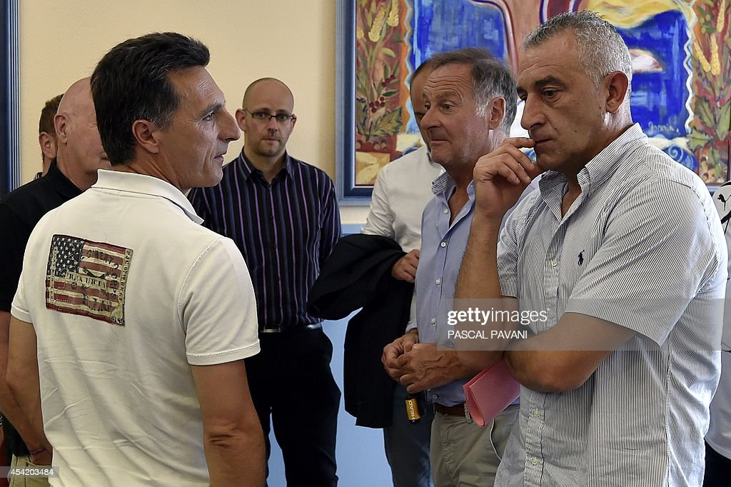 French football club Luzenac Ariege Pyrenees (LAP)'s coach Christophe Pelissier (L) and the team's athletic director Christophe Rodriguez (R) wait after a hearing on August 26, 2014 at the Toulouse administrative court, regarding the club's appeal against the ruling of French Professional Football League (LFP), which decided on August 8, 2014 not to allow the club to play in the French second division. The ruling said: 'The club does not have a ground which conforms to the required safety standards.' The LFP will review the case on August 27 and will decide if the club can integrate or not the French second division.