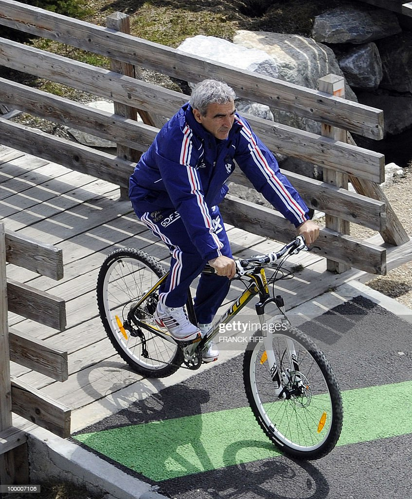 French football coach Raymond Domenech cycles during a training session around a lake, on May 19, 2010 in Tignes in the French Alps, as part of the preparation for the upcoming World Cup 2010. France will play Uruguay in Capetown in its group A opener match on June 11.