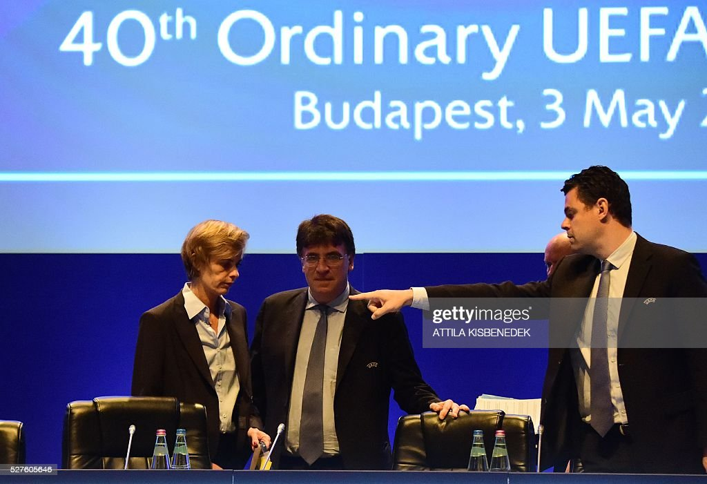 French Football Federation (FFF) director general, Florence Hardouin (L) arrives with UEFA governing body's interim general secretary Theodore Theodoridis (C) and UEFA's Chief of Press Pedro Pinto (R) at the press conference after her admission in UEFAs Executive Committee, during the 40th Ordinary UEFA Congress in Hungexpo Fair Center of Budapest on May 3, 2016. UEFA elected Hardouin as its first female executive member in a landmark vote. / AFP / ATTILA