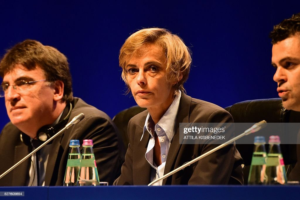 French Football Federation (FFF) director general, Florence Hardouin (L), UEFA governing body's interim general secretary Theodore Theodoridis (C) and UEFA's Chief of Press Pedro Pinto (R) react during the press conference after Hardouin's admission in UEFAs Executive Committee, at the 40th Ordinary UEFA Congress in Hungexpo Fair Center of Budapest on May 3, 2016. UEFA elected Hardouin as its first female executive member in a landmark vote. / AFP / ATTILA