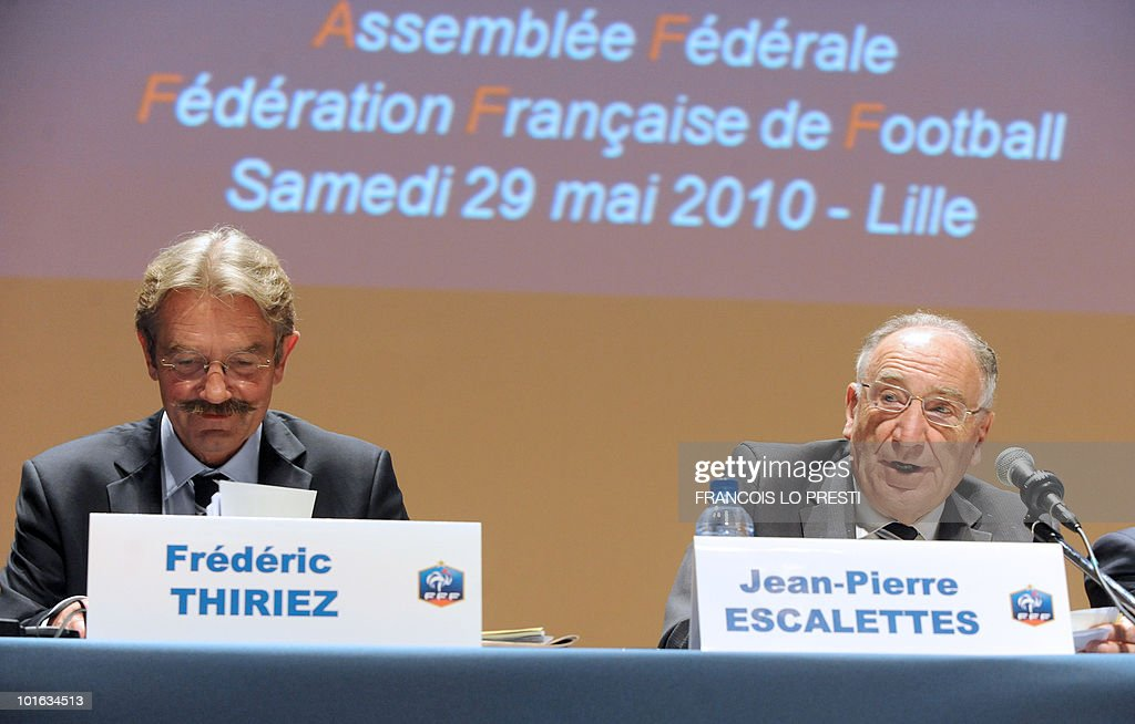 French Football Federation (FFF) president Jean-Pierre Escalettes (R) and French Professional Football League (LFP) president Frederic Thiriez (L) take part in a meeting of the FFF's federal assembly in the French northern city of Lille on May 29, 2010. France were unveiled as hosts of Euro 2016 by UEFA president Michel Platini yesterday, the French bid beating off strong opposition from the two other candidates - Turkey and Italy. The inscription reads: 'Federal Assembly, French football federation, Saturday May 29, 2010 - Lille'.