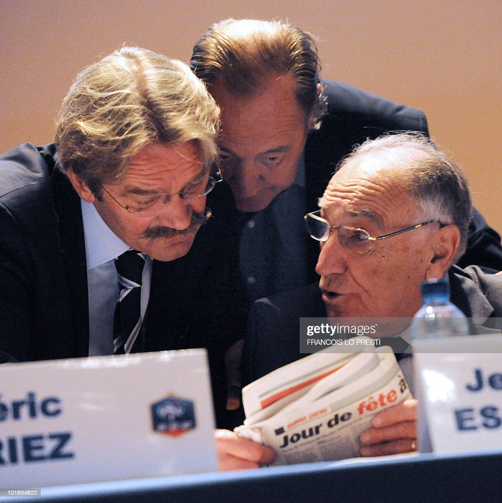 French Football Federation (FFF) president Jean-Pierre Escalettes (R), French Professional Football League (LFP) president Frederic Thiriez (L), Lens' football club president also president of the French professionnal football clubs union Gervais Martel (C) read the sports daily newspaper 'L'Equipe' during a meeting of the FFF's federal assembly in the French northern city of Lille on May 29, 2010. France were unveiled as hosts of Euro 2016 by UEFA president Michel Platini yesterday, the French bid beating off strong opposition from the two other candidates - Turkey and Italy.