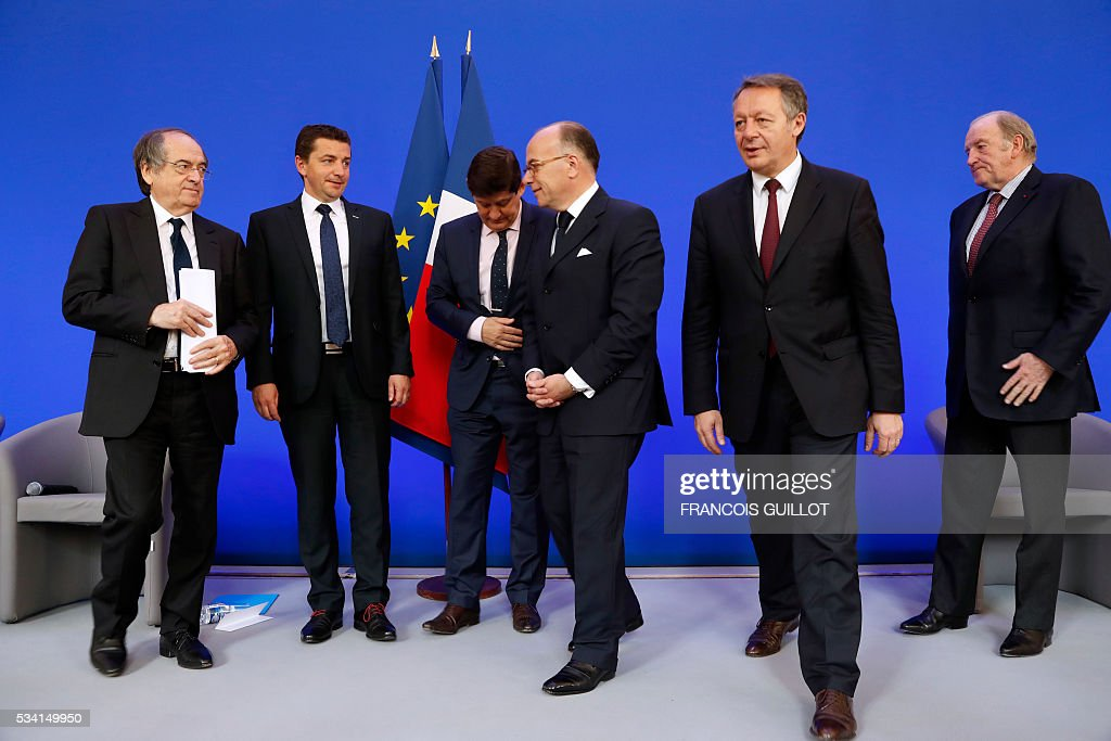 French Football Federation (FFF) president Noel Le Graet, Saint-Etienne's mayor Noel Perdriau, French minister for Cities, Youth and Sport Patrick Kanner , French Interior minister Bernard Cazeneuve, French junior minister for Sports Thierry Braillard and president of the organisation of the Euro 2016 Jacques Lambert stand during a press conference on security measures for the Euro 2016, on May 25, 2016 in Paris. de Ga D le président de la Fédération française de football, Noël Le Graët, Noel Perdriau maire de St Etienne, Patrice Kanner, ministre de la ville de la jeunesse et des sports, Bernard Cazeneuve ministre de l'interieur, Thierry Braillard secretaire d'etat chargé des sports, Jacques Lambert, président société Euro 2016, lors d'une conférence de presse au sujet de la sécurité de l'euro de football le 25 mai 2016 au ministère de l'intérieur a Paris.AFP PHOTO/FRANCOIS GUILLOT France said on May 25, 2016 it will deploy more than 90,000 police and security guards for Euro 2016, vowing to do 'everything possible to avoid a terrorist attack' during the football tournament that starts next month. / AFP / FRANCOIS