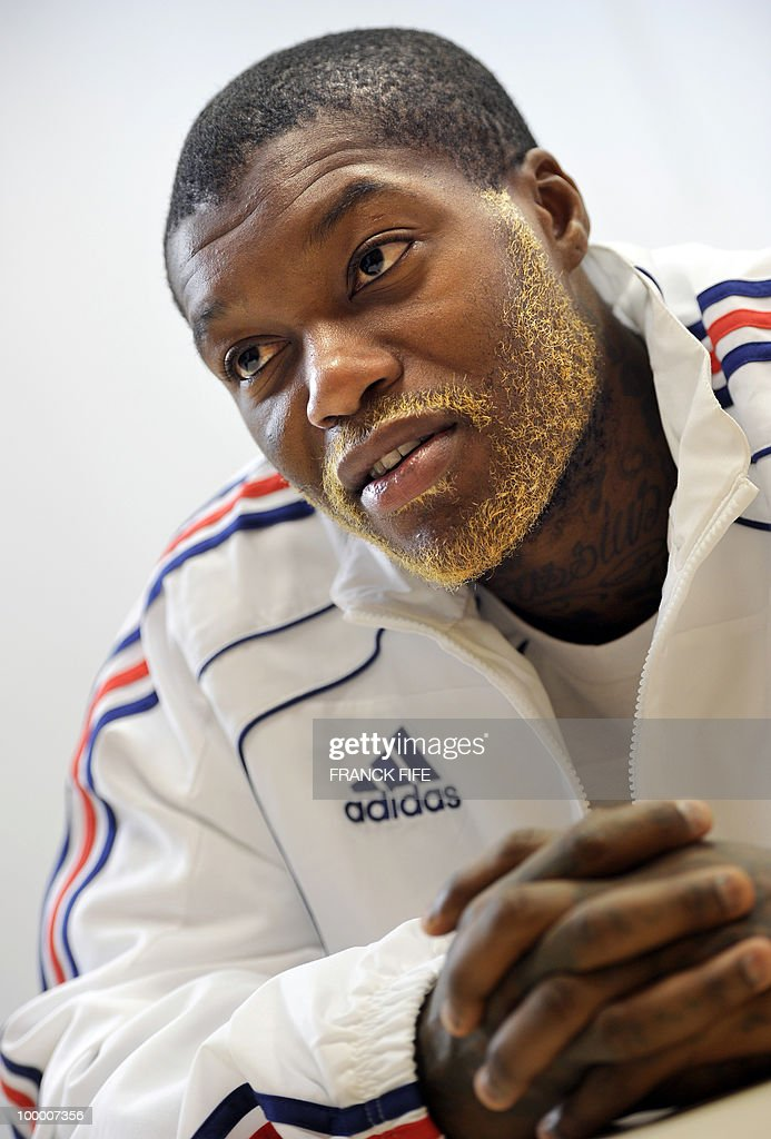 French football forward Djibril Cisse speaks during a press conference in Tignes in the French Alps on May 18, 2010. The French team started in Tignes its preparation for the upcoming FIFA 2010 World Cup. France will play Uruguay in Capetown in its group A opener match on June 11.