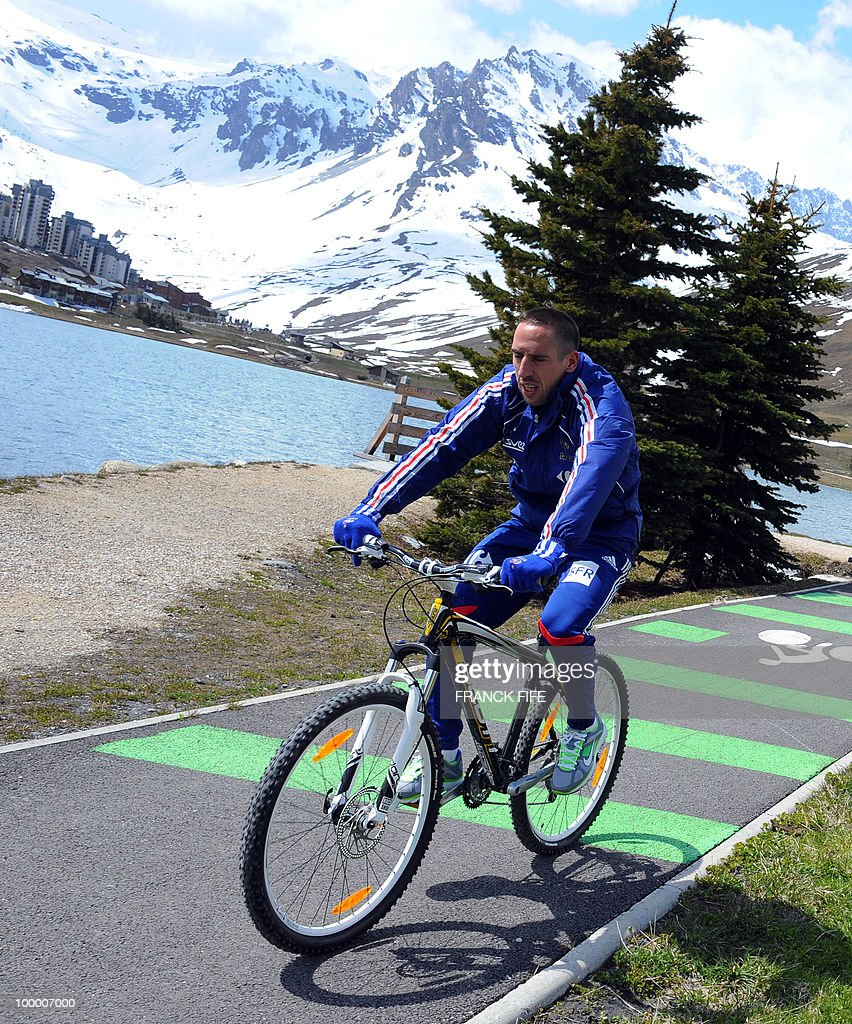 French football forward Franck Ribery cycles around a lake during a training session, on May 19, 2010 in Tignes in the French Alps, as part of the preparation for the upcoming World Cup 2010. France will play Uruguay in Capetown in its group A opener match on June 11.