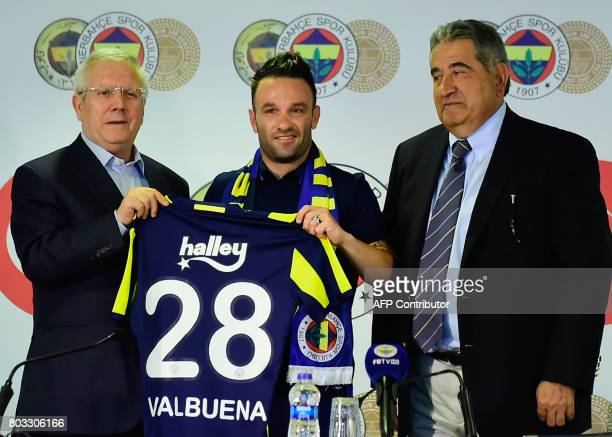 French football midfielder Mathieu Valbuena poses with Fenerbahce's President Aziz Yildirim and vice President Mahmut Uslu during a press conference...