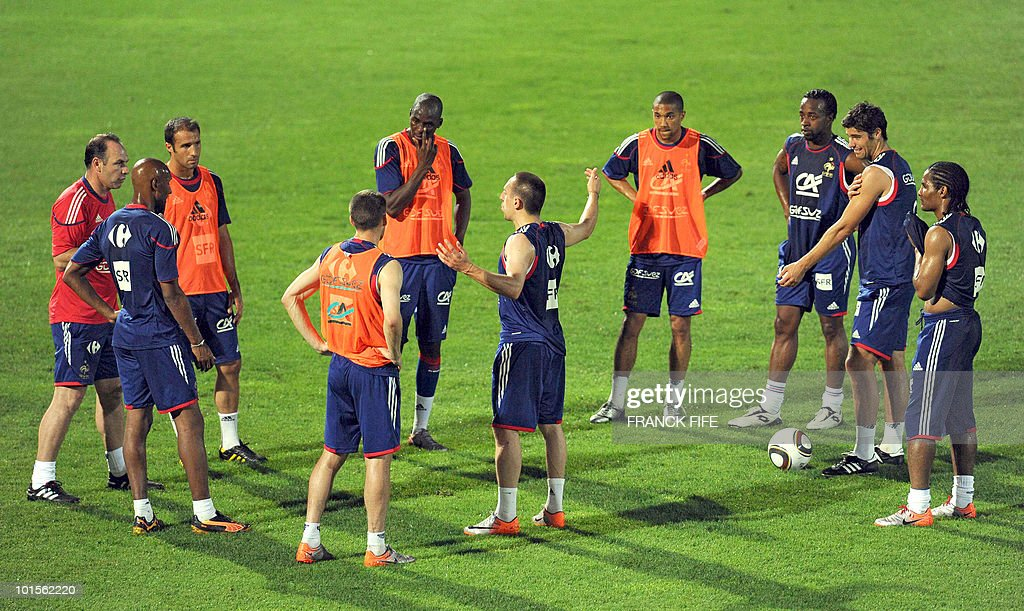 French football national team midfielder Franck Ribery (C) adresses team-mates during a training session on June 2, 2010 at the Michel Volnay stadium in Saint-Pierre, on the French Indian Ocean island of La Reunion, as part of the preparation for the upcoming World Cup 2010. France have one remaining friendly scheduled against China in Reunion on June 4, 2010. They open their World Cup campaign against Uruguay on June 11.