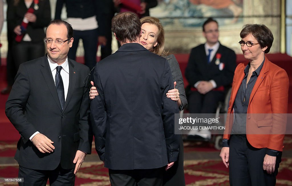French football player and 2012 London Paralympic Games silver medalist Martin Baron (C) is congratulated by France's President Francois Hollande (L), his companion Valerie Trierweiler (C, right) and Sports Minister Valerie Fourneyron (R) after receiving the Knight Award in the National Order of Merit during a ceremony at the Elysee Palace on February 22, 2013 in Paris.