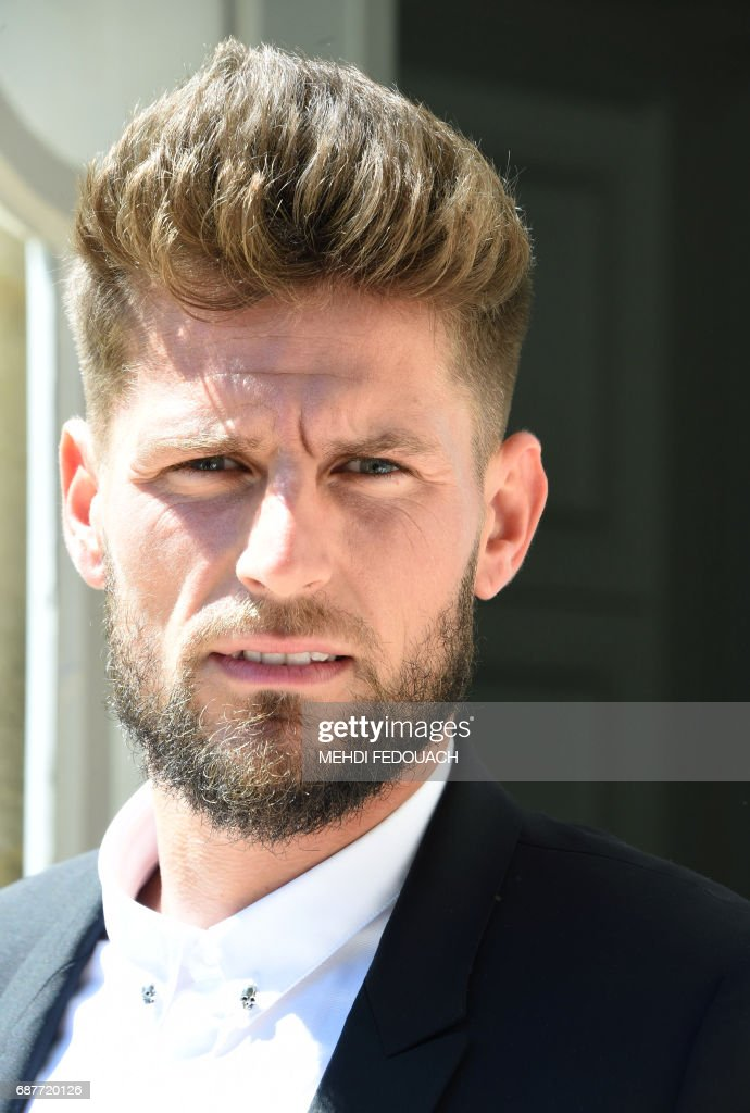 French football player Benoit Costil, the former goalkeeper for Rennes football club, poses for a photograph after signing to play for Girondins de Bordeaux for the next four seasons on May 24, 2017 in Le Haillan. FEDOUACH