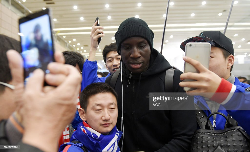 French football player Demba Ba of Shanghai Shenhua club arrives at the airport on February 11, 2016 in Shanghai, China.