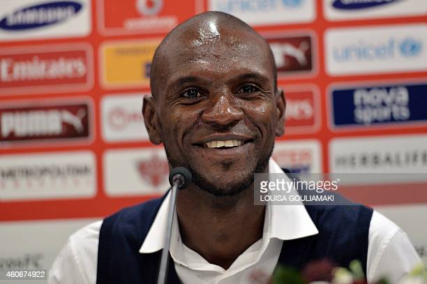 French football player Eric Abidal listens to a question during a press conference at Olympiakos' Karaiskaki Stadium in Piraeus near Athens on...
