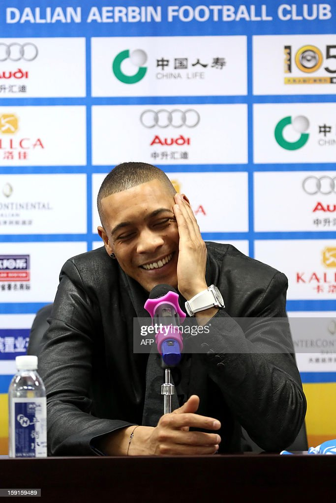 French football player Guillaume Hoarau attends a press conference held by Dalian Aerbin club in Dalian, northeast China's Liaoning province on January 9, 2013. Hoarau has become the latest footballer to be enticed to the big spending Chinese Super League, siging a three year deal with Dalian Aerbin, the club announced on January. CHINA OUT AFP PHOTO