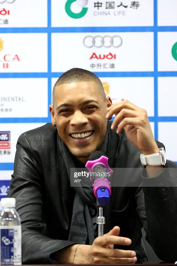 French football player Guillaume Hoarau attends a press conference held by Dalian Aerbin club in Dalian, northeast China's Liaoning province on January 9, 2013. Hoarau has become the latest footballer to be enticed to the big spending Chinese Super League, siging a three year deal with Dalian Aerbin, the club announced on January. CHINA