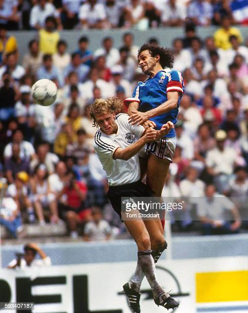 French football player Michel Platini wins a heading duel against his German opponent Wolfgang Rolff during the World Cup football match between...