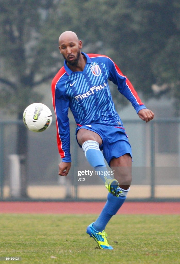 French football player Nicolas Anelka of Shanghai Shenhua in action during a warm-up match between Shanghai Shenhua and Hunan Xiangtao at Shenhua Kangqiao Base on February 21, 2012 in Shanghai, China.
