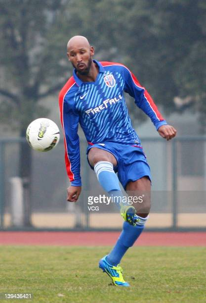 French football player Nicolas Anelka of Shanghai Shenhua in action during a warmup match between Shanghai Shenhua and Hunan Xiangtao at Shenhua...