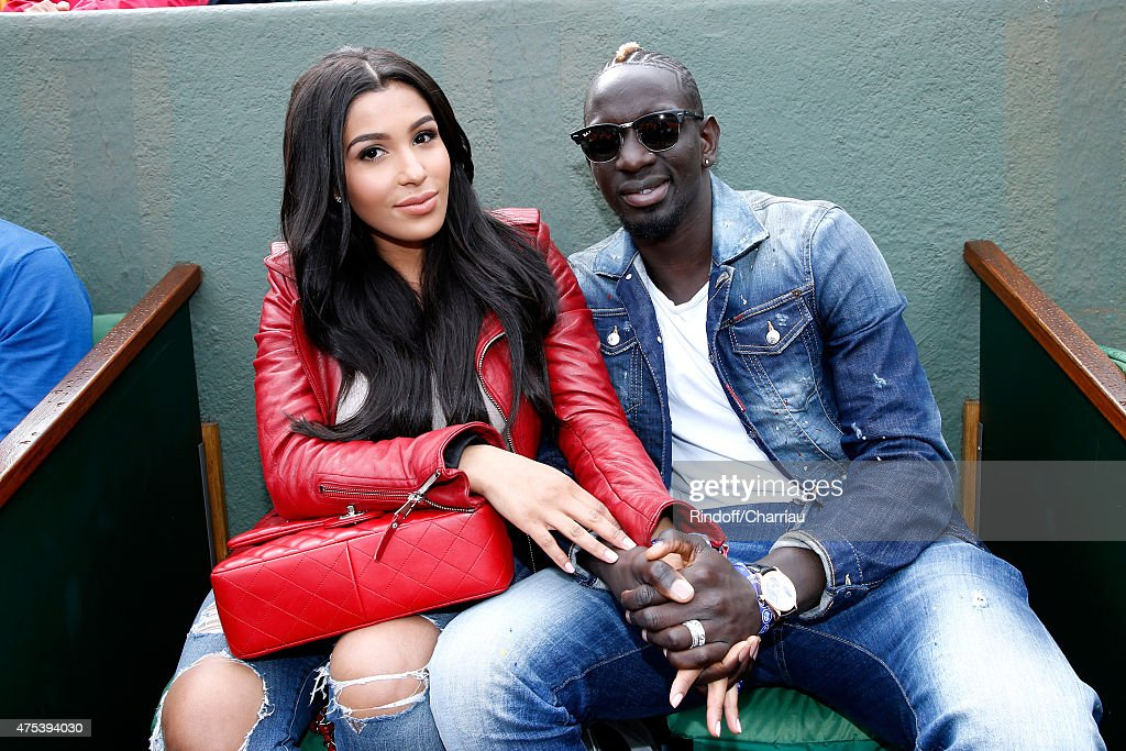 French Football player of Liverpool, Mamadou Sakho (R) and his companion Matja attend the 2015 Roland Garros French Tennis Open - Day Eight, on May 31, 2015 in Paris, France.