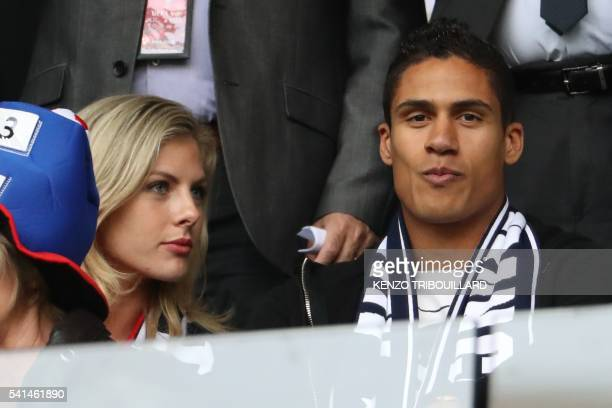 French football player Raphael Varane and his gilfriend Camille Tytgat attend the Euro 2016 group A football match between Switzerland and France at...