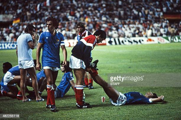 French football players including Michel Platini Dominique Rocheteau and Didier Six prepare for extra time on July 8 1982 during the World Cup...
