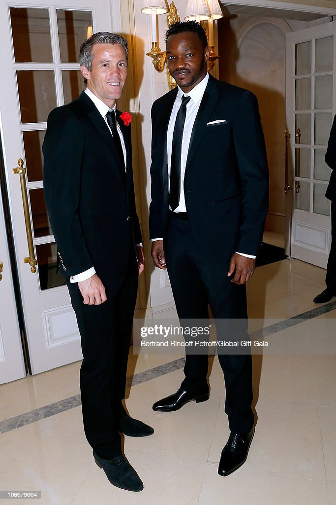 French football players <a gi-track='captionPersonalityLinkClicked' href=/galleries/search?phrase=Mickael+Landreau&family=editorial&specificpeople=490956 ng-click='$event.stopPropagation()'>Mickael Landreau</a> and <a gi-track='captionPersonalityLinkClicked' href=/galleries/search?phrase=Steve+Mandanda&family=editorial&specificpeople=4470005 ng-click='$event.stopPropagation()'>Steve Mandanda</a> attend 'Global Gift Gala' at Hotel George V on May 13, 2013 in Paris, France.