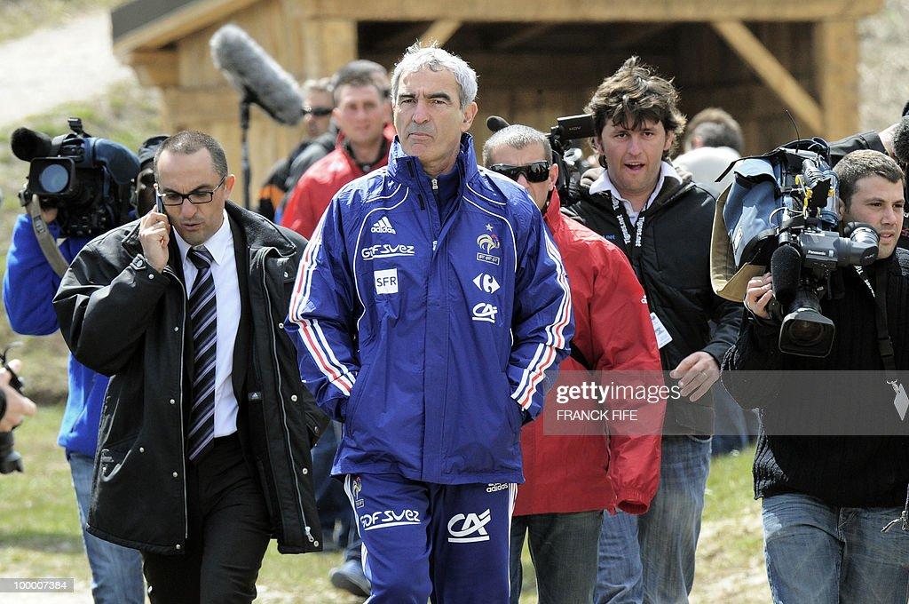 French football team coach Raymond Domenech (C) walks surrounded by the press before a training session on May 19, 2010 in Tignes in the French Alps, as part of the preparation for the upcoming World Cup 2010. France will play Uruguay in Capetown in its group A opener match on June 11.