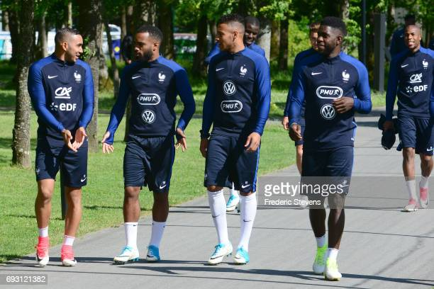 French Football Team forward Dimitry Payet Alexandre Lacazette midfielder Corentin Tolisso and defender Samuel Umtiti arrive for the training session...