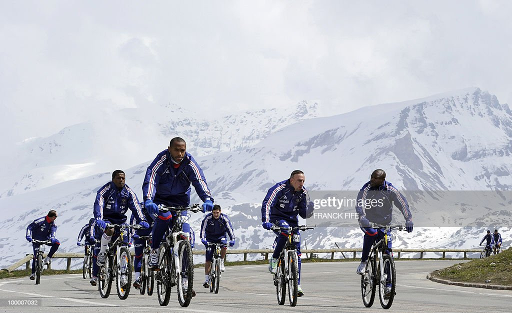 French football team members cycle during a training session around a lake, on May 19, 2010 in Tignes in the French Alps, as part of the preparation for the upcoming World Cup 2010. France will play Uruguay in Capetown in its group A opener match on June 11.