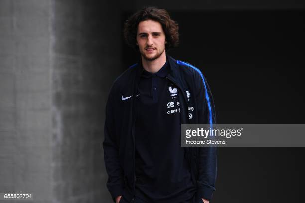 French Football Team midfielder Adrien Rabiot arrives for the press conference before the training session on March 20 2017 in Clairefontaine France...