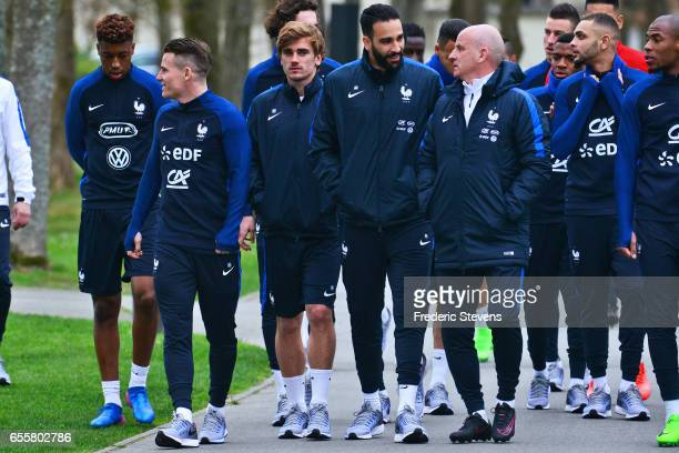 French Football Team Presnel Kimpembe Kevin Gameiro Antoine Griezmann Adil Rami and assistant coach Guy Stephan arrive for the training session on...