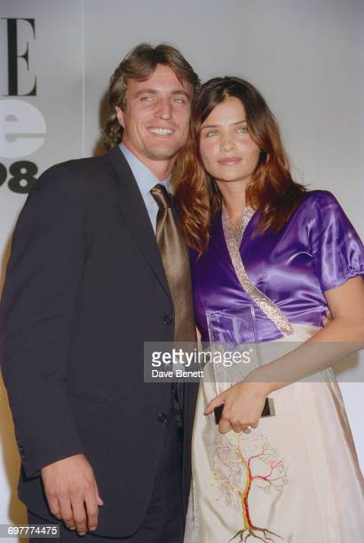 French footballer David Ginola and Danish fashion model Helena Christensen at the Elle Magazine Style Awards at Sound Republic in Leicester Square...