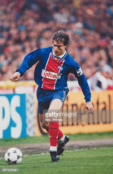 French footballer David Ginola in action for Paris Saint Germain during the European Cup semifinal 2nd leg against AC Milan at Parc des Princes Paris...