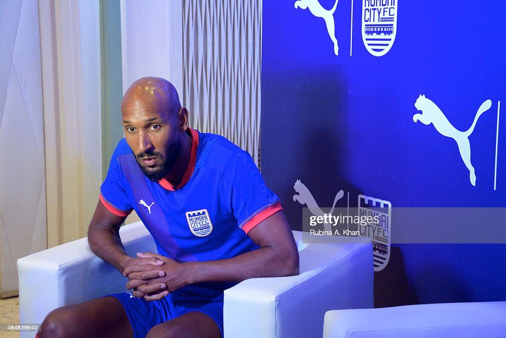 French footballer <a gi-track='captionPersonalityLinkClicked' href=/galleries/search?phrase=Nicolas+Anelka&family=editorial&specificpeople=206204 ng-click='$event.stopPropagation()'>Nicolas Anelka</a> at the unveiling of the new Puma Mumbai City FC jersey and kit by Bollywood star, Ranbir Kapoor, who co-owns the Mumbai City FC team on August 22, 2015 in Mumbai, India.