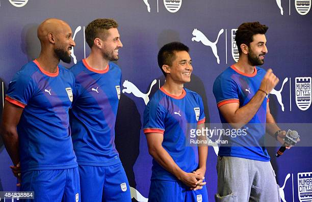 French footballer Nicolas Anelka Brazilian footballer Andre Moritz and Indian striker Sunil Chhetri with Bollywood star Ranbir Kapoor and coowner of...