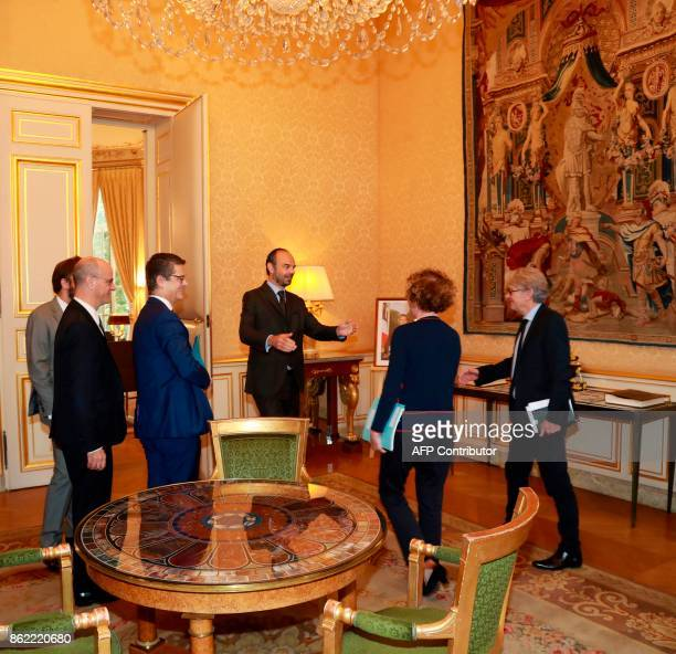 French Force Ouvriere labour union General Secretary JeanClaude Mailly stands with French Labour Minister Muriel Pénicaud as they arrive at Hotel de...