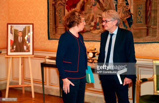 French Force Ouvriere labour union General Secretary JeanClaude Mailly speaks with French Labour Minister Muriel Pénicaud as they arrive at Hotel de...