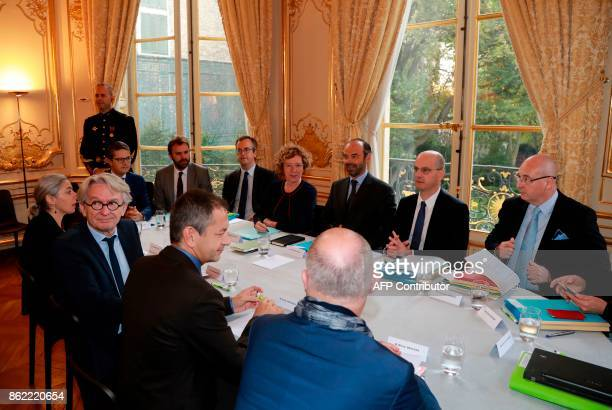 French Force Ouvriere labour union General Secretary JeanClaude Mailly sits with French Labour Minister Muriel Pénicaud as they commence talks with...