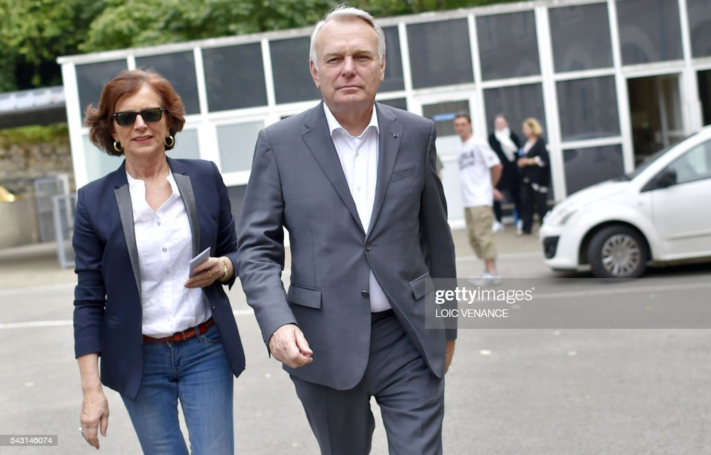 French Foreign Affairs minister and former mayor of Nantes Jean-Marc Ayrault (R) and his wife Brigitte arrive to vote on June 26, 2016, in Nantes during a local referendum organized in Loire Atlantique regarding the transfer of the Nantes Atlantique airport to Notre-Dame-des-Landes. Nearly One million people living in France's Loire-Atlantique department are voting in a referendum which poses the question 'Are you in favour of the project to transfer the Nantes-Atlantique airport to the municipality of de Notre-Dame-des-Landes?' to voters. The referendum was organised by the French executive power hoping to find a solution to the issue which has dragged on for 50 years. / AFP / LOIC
