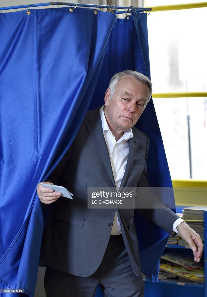 French Foreign Affairs Minister and former mayor of Nantes Jean-Marc Ayrault leaves a polling booth on June 26, 2016, in Nantes during a local referendum organised in Loire Atlantique regarding the transfer of the Nantes Atlantique airport to Notre-Dame-des-Landes. Nearly one million people living in France's Loire-Atlantique department are voting in a referendum which poses the question 'Are you in favour of the project to transfer the Nantes-Atlantique airport to the municipality of Notre-Dame-des-Landes?' to voters. The referendum was organised by the French executive power hoping to find a solution to the issue which has dragged on for 50 years. / AFP / LOIC
