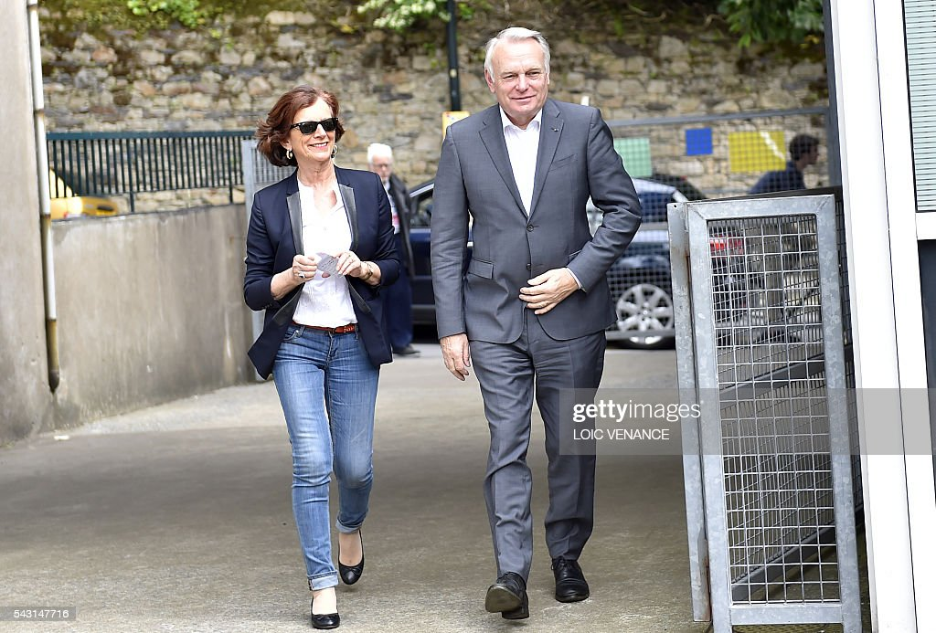 French Foreign Affairs minister and former mayor of Nantes Jean-Marc Ayrault (R) and his wife Brigitte arrive to vote on June 26, 2016, in Nantes during a local referendum organised in Loire Atlantique regarding the transfer of the Nantes Atlantique airport to Notre-Dame-des-Landes. Nearly One million people living in France's Loire-Atlantique department are voting in a referendum which poses the question 'Are you in favour of the project to transfer the Nantes-Atlantique airport to the municipality of de Notre-Dame-des-Landes?' to voters. The referendum was organised by the French executive power hoping to find a solution to the issue which has dragged on for 50 years. / AFP / LOIC