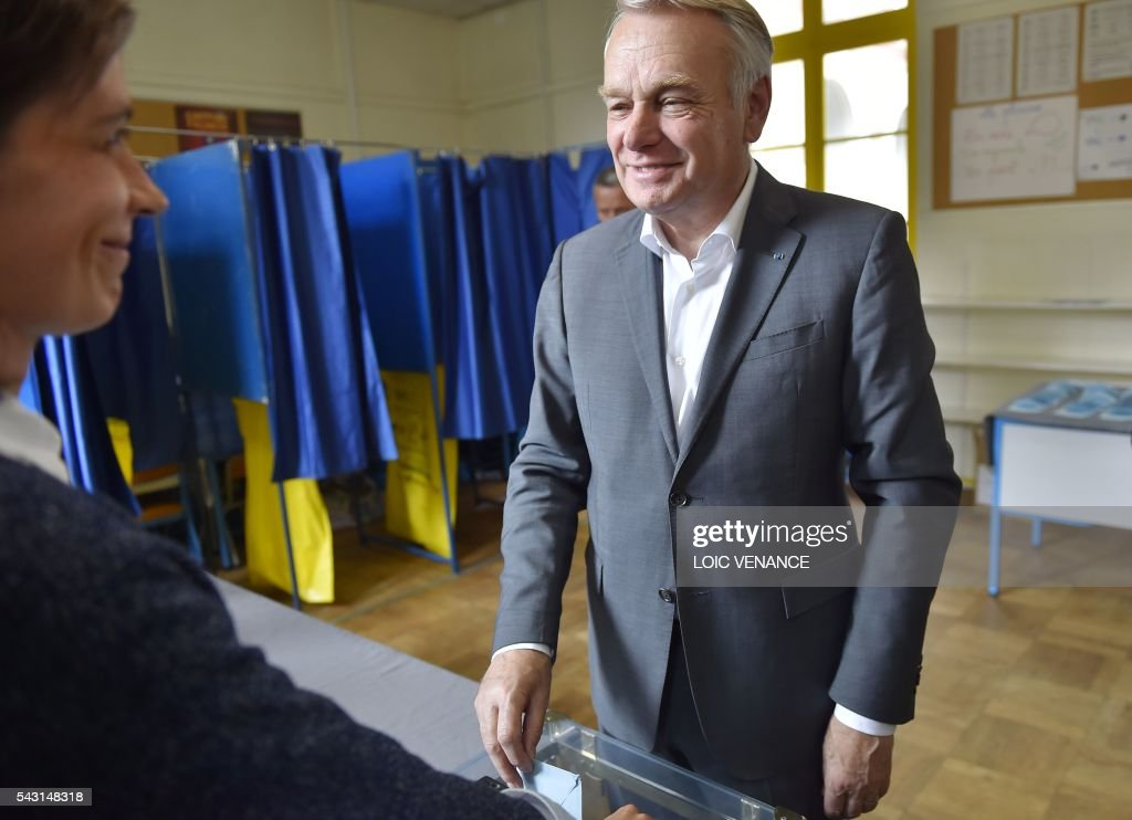 French Foreign Affairs minister and former mayor of Nantes Jean-Marc Ayrault casts his ballot on June 26, 2016, in Nantes during a local referendum organized in Loire Atlantique regarding the transfer of the Nantes Atlantique airport to Notre-Dame-des-Landes. Nearly One million people living in France's Loire-Atlantique department are voting in a referendum which poses the question 'Are you in favour of the project to transfer the Nantes-Atlantique airport to the municipality of de Notre-Dame-des-Landes?' to voters. The referendum was organised by the French executive power hoping to find a solution to the issue which has dragged on for 50 years.