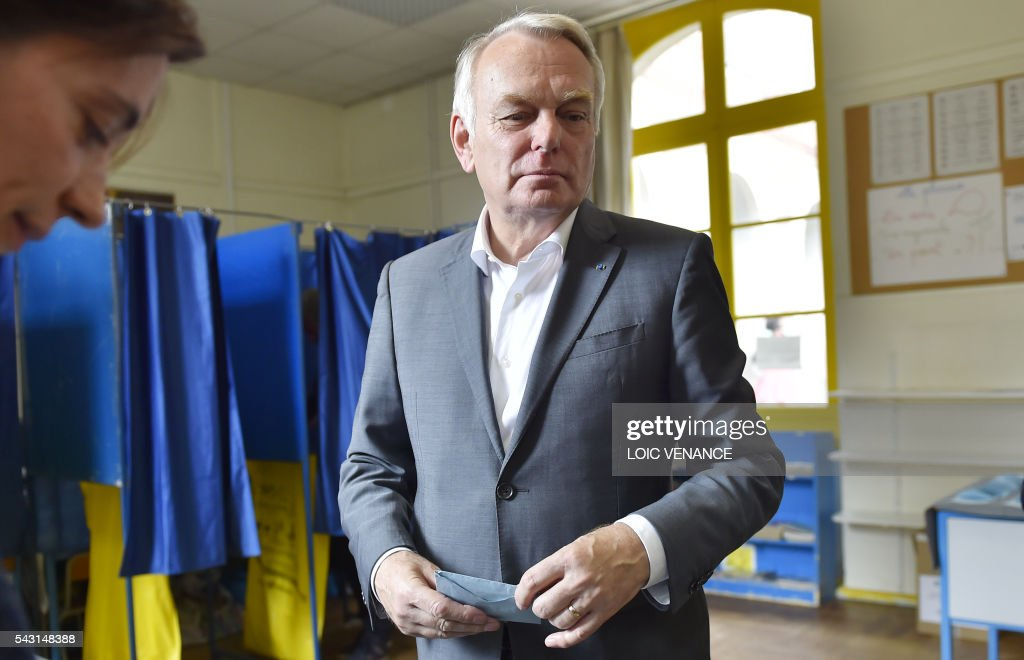 French Foreign Affairs minister and former mayor of Nantes Jean-Marc Ayrault prepares to cast his ballot on June 26, 2016, in Nantes during a local referendum organized in Loire Atlantique regarding the transfer of the Nantes Atlantique airport to Notre-Dame-des-Landes. Nearly One million people living in France's Loire-Atlantique department are voting in a referendum which poses the question 'Are you in favour of the project to transfer the Nantes-Atlantique airport to the municipality of de Notre-Dame-des-Landes?' to voters. The referendum was organised by the French executive power hoping to find a solution to the issue which has dragged on for 50 years.