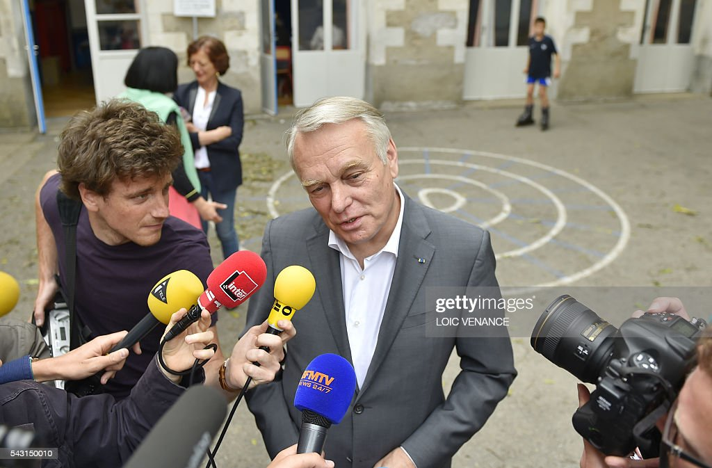 French Foreign Affairs minister and former mayor of Nantes Jean-Marc Ayrault talks to journalists after voting on June 26, 2016, in Nantes during a local referendum organised in Loire Atlantique regarding the transfer of the Nantes Atlantique airport to Notre-Dame-des-Landes. Nearly One million people living in France's Loire-Atlantique department are voting in a referendum which poses the question 'Are you in favour of the project to transfer the Nantes-Atlantique airport to the municipality of de Notre-Dame-des-Landes?' to voters. The referendum was organised by the French executive power hoping to find a solution to the issue which has dragged on for 50 years. / AFP / LOIC